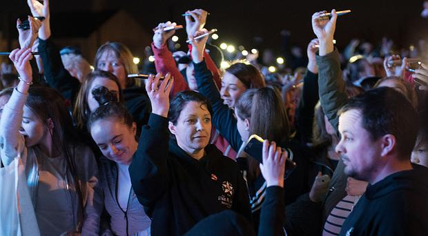 Louise James in the crowd as phones are held aloft in remembrance