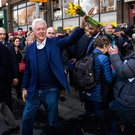 Former US President Bill Clinton waves to the public after a visit to the Kilkenny Shop in Dublin's Nassau Street yesterday