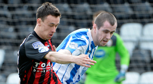 Turning up the heat: Coleraine defender David Ogilby tracks Crusaders winger Paul Heatley during a Danske Bank Premiership clash last year