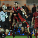 Big hit: Scarlets' Gareth Davies is tackled by Duncan Weir of Edinburgh
