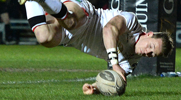 Touchdown: Craig Gilroy goes over for a try in Ulster's win over the Dragons