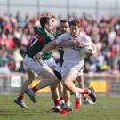 Battling it out: Tyrone's Padraig McNulty in action with Mayo's Patrick Durcan