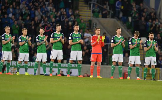A minute's applause for Derry's Ryan McBride before the World Cup qualifier at Windsor park in Belfast. Photo Colm Lenaghan/Pacemaker Press