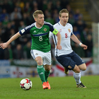 Eyeing glory: Northern Ireland's Steven Davis aims to escape Stefan Johansen