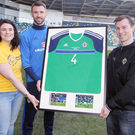 Digging deep: Gareth McAuley presents his shirt from the win over Ukraine to supporter Mark Harrison who won a raffle which raised more than £10,000 for Cancer Fund for Children. Sorcha Mac Laimhin (left), Corporate Fundraiser at the charity, hands over the fantastic prize