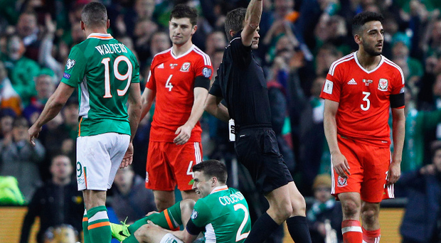 Off colour: Neil Taylor is dismissed as Seamus Coleman comes to terms with his horrific injury