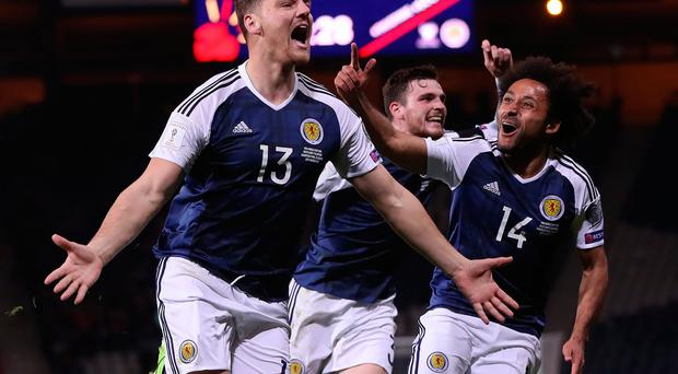 Glory boy: Chris Martin came to Scotland's rescue last night