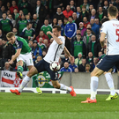 Perfect start: Jamie Ward turns to shoot Northern Ireland ahead
