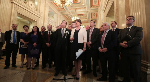 DUP leader Arlene Foster, deputy leader Nigel Dodds and party colleagues pictured during a press conference at Parliament Buildings Stormont (Photo by Kelvin Boyes / Press Eye)