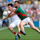 Flashpoint: Tyrone's Mattie Donnelly (left) clashed with Aidan O'Shea at the weekend