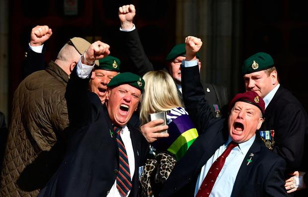Supporters of Alexander Blackman celebrate outside the Royal Courts of Justice in London as the Royal Marine could be freed from prison within weeks after the Court Martial Appeal Court sentenced him to seven years for the manslaughter of an injured Taliban fighter in Afghanistan.
