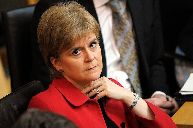 Scottish First Minister Nicola Sturgeon listens in the chamber as she attends a debate on a second referendum on independence at Scotland's Parliament in Holyrood on March 28, 2017 in Edinburgh, United Kingdom. (Photo by Andy Buchanan - WPA Pool /Getty Images)