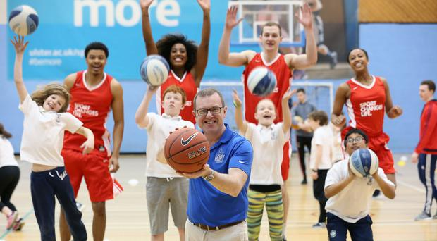 Life lessons: Barry Funston, front, Chief Executive of the Rory Foundation, with Victory Scholars students from the US and young local sportspeople who will be aided by the Foundation's Irish Open charity partnership with Sport Changes Life, announced by Rory McIlroy