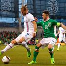 Iceland's Rurik Gislason (left) and Republic of Ireland's Robbie Brady during the International Friendly match at the Aviva Stadium, Dublin. PA