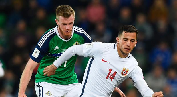 Keeping watch: Chris Brunt keeps an eye on Norway ace Omar Elabdellaoui during Northern Ireland's victory at Windsor Park