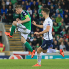 All under control: Northern Ireland captain Steven Davis pulls the strings against Norway and boss Michael O'Neill calls the shots from the dugout