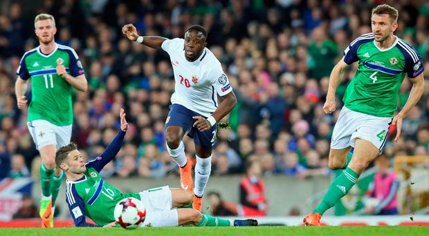 Ground force: Oliver Norwood puts in a challenge on Norway's Adama Diomande on Sunday night at Windsor Park