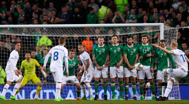 Curling home: Hordur Bjorgvin Magnusson bends a free-kick into the Republic of Ireland net