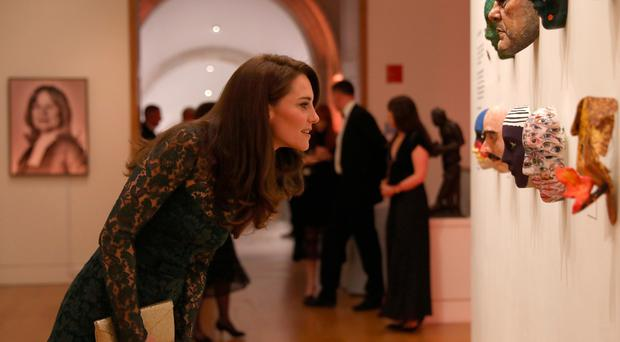 The Duchess of Cambridge views artworks during the 2017 Portrait Gala at the National Portrait Gallery in London