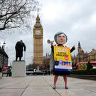 A giant headed Theresa May in Parliament Square, London during a protest by Avaaz after PM signed a letter to trigger Article 50 that starts the formal exit process by the UK from the European Union. Pic: PA Wire