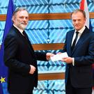 Britain's ambassador to the EU Tim Barrow delivers British Prime Minister Theresa May's formal notice of the UK's intention to leave the bloc under Article 50 of the EU's Lisbon Treaty to European Council President Donald Tusk in Brussels on March 29, 2017.