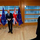 Britain's ambassador to the EU Tim Barrow (R) leaves after delivering British Prime Minister Theresa May's formal notice of the UK's intention to leave the bloc under Article 50 of the EU's Lisbon Treaty to European Council President Donald Tusk (L) in Brussels on March 29, 2017. Pic PA wire