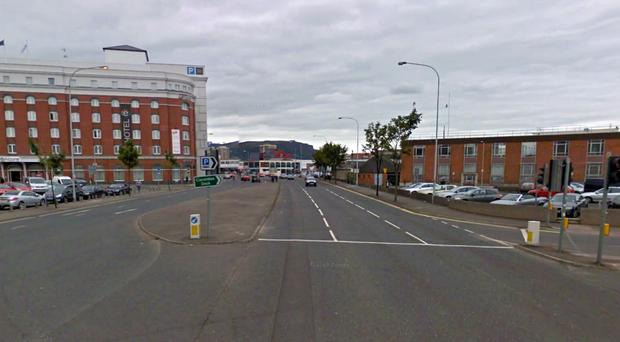 The victim had been Christmas shopping with a friend during a visit to Belfast.