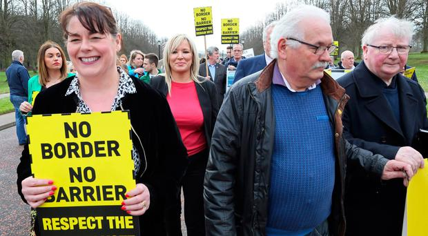 Sinn Fein's Northern Leader Michelle O'Neill (C) joins members of the anit-brexit campaign group