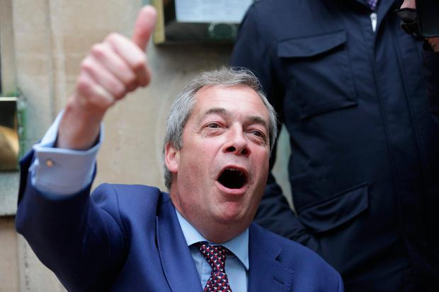 Former leader of the anti-EU UK Independence Party (UKIP) Nigel Farage reacts after being congratulated in the garden of a pub in Westminster in London on March 29, 2017. AFP/Getty Images