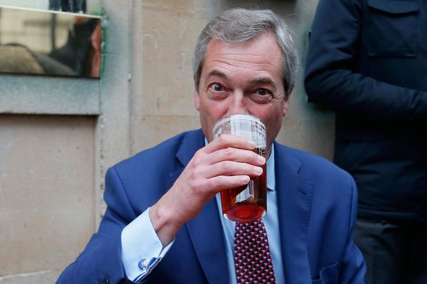 Former leader of the anti-EU UK Independence Party (UKIP) Nigel Farage drinks outside a pub in Westminster in London on March 29, 2017. AFP/Getty Images