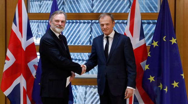 Britain's permanent representative to the European Union, Tim Barrow (left), hand delivers Prime Minister Theresa May's Brexit letter notifying the EU of the UK's intention to leave the bloc