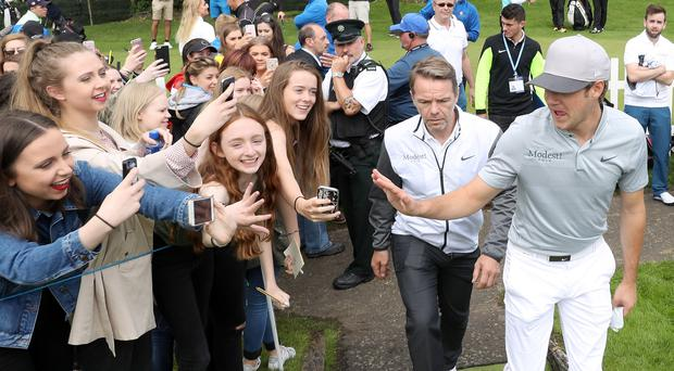 In demand: One Direction singer Niall Horan with fans at the 2016 NI Open Pro-Amtators,