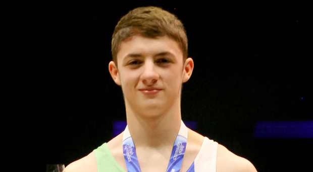 Gold standard: Rhys McClenaghan shows off his prize after Pommel joy