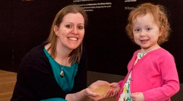 Four-year-old Lucy Boucher with Selina Hurley, curator of the Medicine Galleries Project at the Science Museum in London