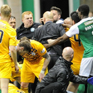 Boiling point: Hibs boss Neil Lennon squares up to Morton manager Jim Duffy as tempers flare