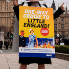 A Brexit protester makes their point outside the Houses of Parliament
