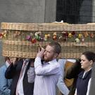 The remains of the late Danielle McLaughlin is carried into St Marys Church, Cockhill. Danielle McLaughlin, from County Donegal, was found dead in a field close to tourist resorts in the western state of Goa earlier this month. Joe Bolan / Press Eye.com
