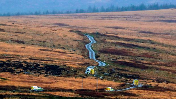 RAF mountain rescue service vehicles on a road near Trawsfynydd in the Snowdonia mountain range in north Wales where the wreckage has been discovered of a Twin Squirrel helicopter which went missing Wednesday while flying to Dublin from the south of England. PA