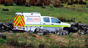 An RAF mountain rescue service vehicle on a road near Trawsfynydd in the Snowdonia mountain range in north Wales near where the wreckage has been discovered of a Twin Squirrel helicopter which went missing Wednesday while flying to Dublin from the south of England. PA