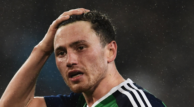 On the sidelines: Corry Evans will miss NI's World Cup qualifier in Azerbaijan in June