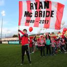 Members of the Derry City FC Cubs who released balloons in memory of club captain Ryan McBride prior to kick off. Photo Lorcan Doherty / Presseye.com