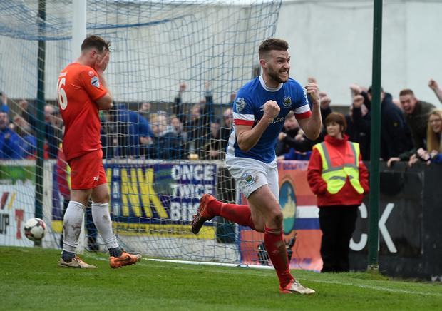 Linfield's Stephen Lowry scores his side's late winner at Mournview Park. Photo Charles McQuillan/Pacemaker Press