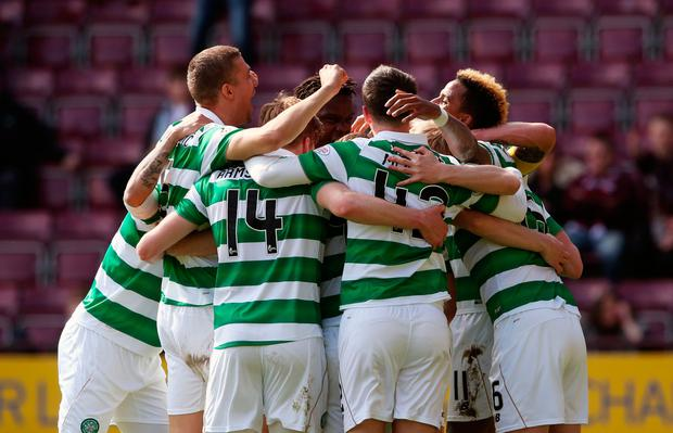 Celtic's Scott Sinclair (right, obscured) celebrates scoring his side's fifth goal of the game from the penalty spot and completing his hat-trick with team-mates during the Ladbrokes Scottish Premiership match at Tynecastle Stadium, Edinburgh. PA