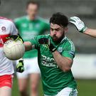 Fermanagh's Kane Connor with Derry's Benny Herron during their Allianz FL Division 2 game at Brewster pk, Enniskillen. Presseye