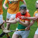 Carlow's John Michael Nolan in action against Antrim's Conor McKinley, Paul Shiels, Conor McCann and Eoghan Campbell - Pic by Dylan McIlwaine Press Eye/INPHO