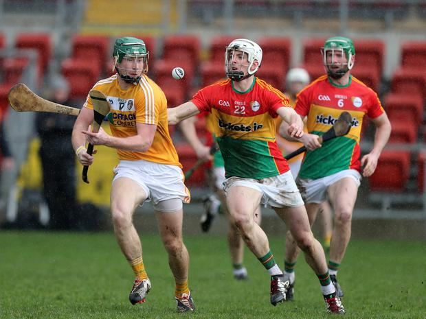 Antrim's Niall McKenna in action against Carlow's James Doyle - Pic by Dylan McIlwaine Press Eye/INPHO