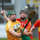 Job done: Antrim's Conor Johnston keeps possession against Carlow at Pairc Esler