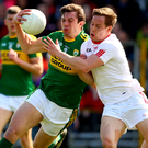 Close quarters: Kerry's David Moran is tackled by Kieran McGeary