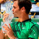 Express delivery: Federer celebrates victory in Miami Open last night