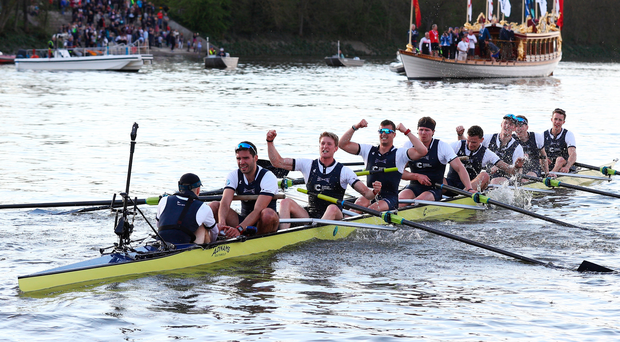 Home in a boat: Oxford celebrate victory in the men's race